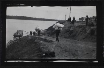 Loading H.B.C. barges at Prince Albert for trading posts along the North Sask (multiple), ca. 1870. PAS R-A4369